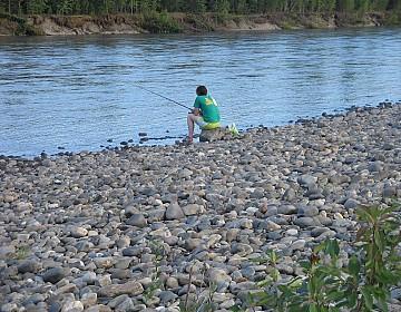 Gillian fishing on Stewart River